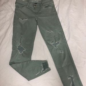 green distressed jeans